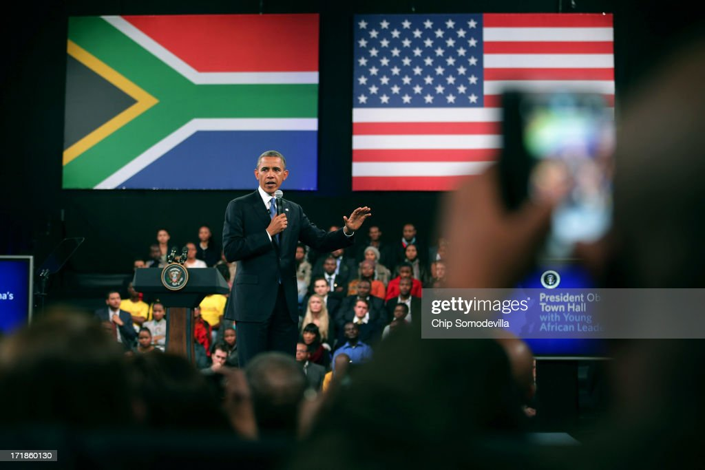 U.S. President <a gi-track='captionPersonalityLinkClicked' href=/galleries/search?phrase=Barack+Obama&family=editorial&specificpeople=203260 ng-click='$event.stopPropagation()'>Barack Obama</a> takes questions from the audience and from people in Nigeria, Uganda and Kenya via live link during a 'town hall' meeting with the young African leaders at the University of Johannesburg in Soweto June 29, 2013 in Johannesburg, South Africa. South Africa is the second leg of Obama's three-country tour of the African continent, which includes Senegal and Tanzania.