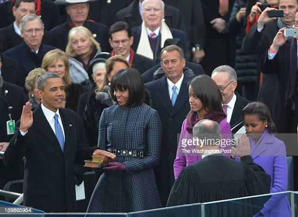President Barack Obama takes the oath of office administered by Chief Justice Johns Roberts during the 57th Presidential Inauguration Ceremony at the...
