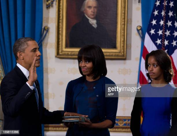 US President Barack Obama takes the oath of office at the official swearingin ceremony in the Blue Room of the White House in Washington on January...