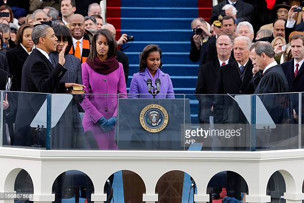 President Barack Obama takes the oath of office from Chief Justice John Roberts at the ceremonial swearingin at the US Capitol during the 57th...