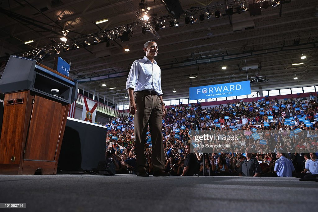S President Barack Obama takes the stage at a campaign rally at the Kissimmee Civic Center September 8 2012 in Kissimmee Florida Working with the...