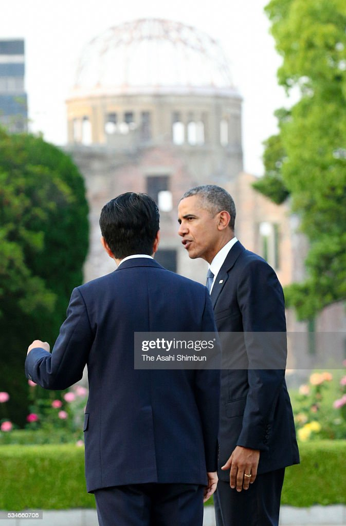 U.S. President <a gi-track='captionPersonalityLinkClicked' href=/galleries/search?phrase=Barack+Obama&family=editorial&specificpeople=203260 ng-click='$event.stopPropagation()'>Barack Obama</a> talk to Japanese Prime Minister <a gi-track='captionPersonalityLinkClicked' href=/galleries/search?phrase=Shinzo+Abe&family=editorial&specificpeople=559017 ng-click='$event.stopPropagation()'>Shinzo Abe</a> after offering wreaths at the cenotaph at the Hiroshima Peace Memorial Park on May 27, 2016 in Hiroshima, Japan. Obama becomes the first sitting U.S. president to visit Hiroshima, where the first atomic bomb was dropped in 1945 at the end of World War II.