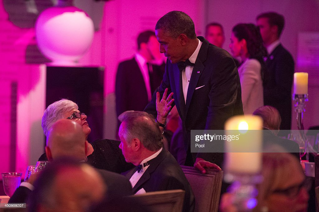 U.S. President Barack Obama talks to guest during a dinner for Medal of Freedom awardees at the Smithsonian National Museum of American History on November 20, 2013 in Washington, DC. The Presidential Medal of Freedom is the nation's highest civilian honor, presented to individuals who have made meritorious contributions to the security or national interests of the United States, to world peace, or to cultural or other significant public or private endeavors.