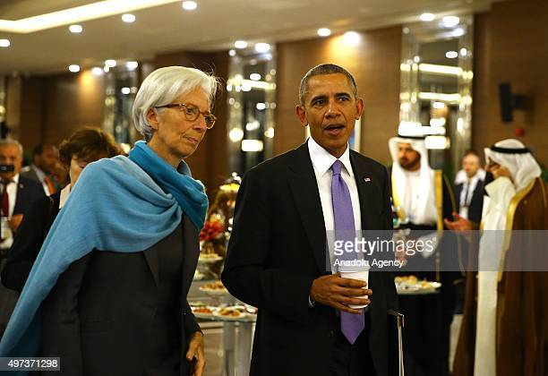 President Barack Obama talks to International Monetary Fund Managing Director Christine Lagarde as they arrive for a working lunch on day two of the...