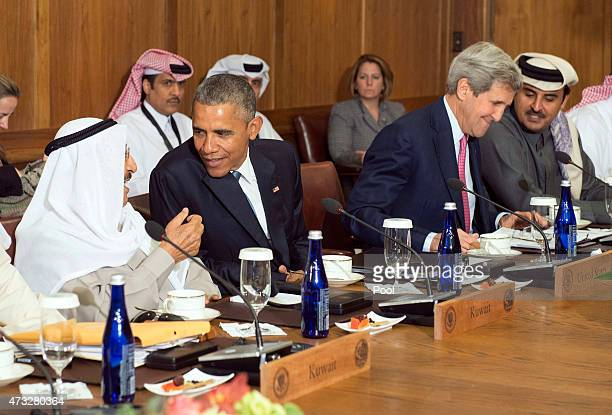 S President Barack Obama talks to Sheikh Sabah AlAhmed AlJaber AlSabah Amir of the State of Kuwait while Secretary of State John Kerry talks to...