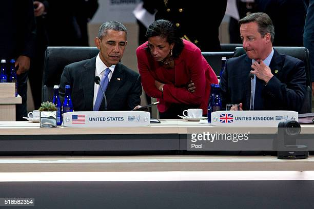 US President Barack Obama talks to Susan Rice US national security advisor during a closing session with David Cameron UK prime minister at the...