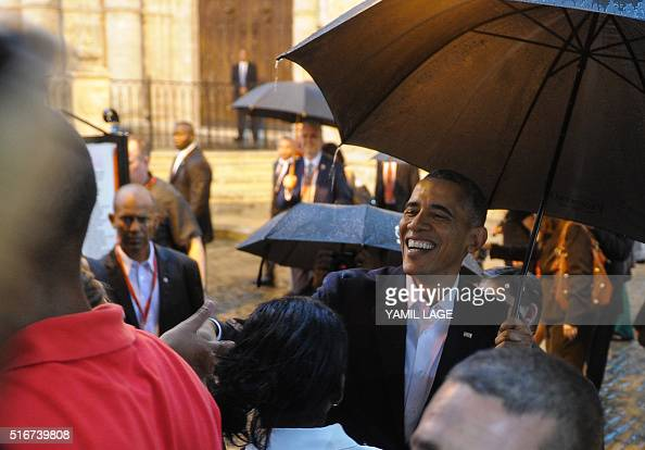 President Barack Obama talks to tourists and Cubans at his arrival to the Havana Cathedral on March 20 2016 On Sunday Obama became the first US...