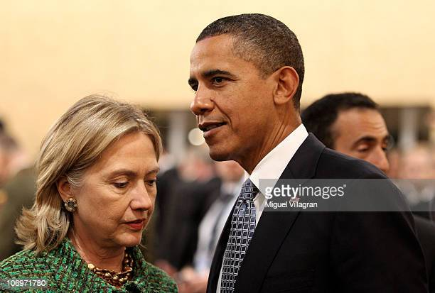 S President Barack Obama talks to US Secretary of State Hillary Clinton before the North Atlantic Meeting during the NATO Summit 2010 at Feira...