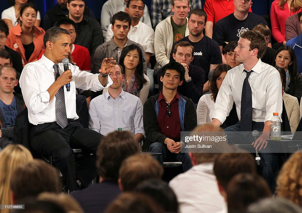 U.S. President Barack Obama (L) talks with Facebook CEO Mark Zuckerberg during a town hall style meeting at Facebook headquarters on April 20, 2011 in Palo Alto, California. The president used the opportunity to outline his views on the budget deficit ahead of a looming battle with congressional Republicans over fiscal matters.