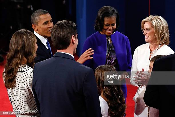 S President Barack Obama talks with first lady Michelle Obama Ann Romney and Matt Romney after the conclusion of the Presidential Debate at the...
