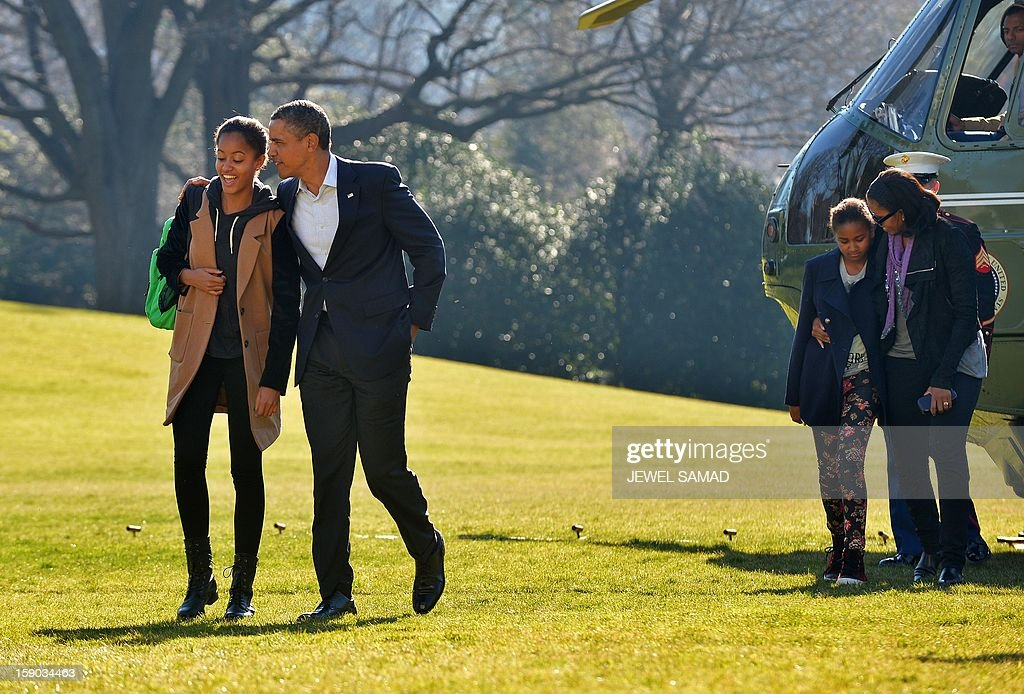 US President Barack Obama (2nd-L) talks with his daughter Malia (L) as First Lady Michelle Obama and Sasha follow upon their return at the White House in Washington, DC, on January 6, 2013. Obama and his family returned in Washington, DC, from Hawaii where they had spent a Christmas vacation. AFP PHOTO/Jewel Samad