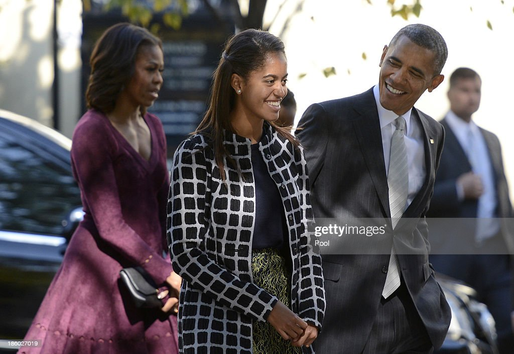 U.S. President <a gi-track='captionPersonalityLinkClicked' href=/galleries/search?phrase=Barack+Obama&family=editorial&specificpeople=203260 ng-click='$event.stopPropagation()'>Barack Obama</a> talks with his daughter <a gi-track='captionPersonalityLinkClicked' href=/galleries/search?phrase=Malia+Obama&family=editorial&specificpeople=2631620 ng-click='$event.stopPropagation()'>Malia Obama</a> (L) as they walk from St John's Church to the White House after service October 27, 2013 in Washington, DC. Obama is scheduled to travel to Boston this week.
