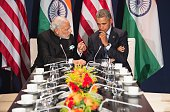 US President Barack Obama talks with Indian Prime Minister Narendra Modi during a meeting at the UN conference on climate change COP21 on November 30...