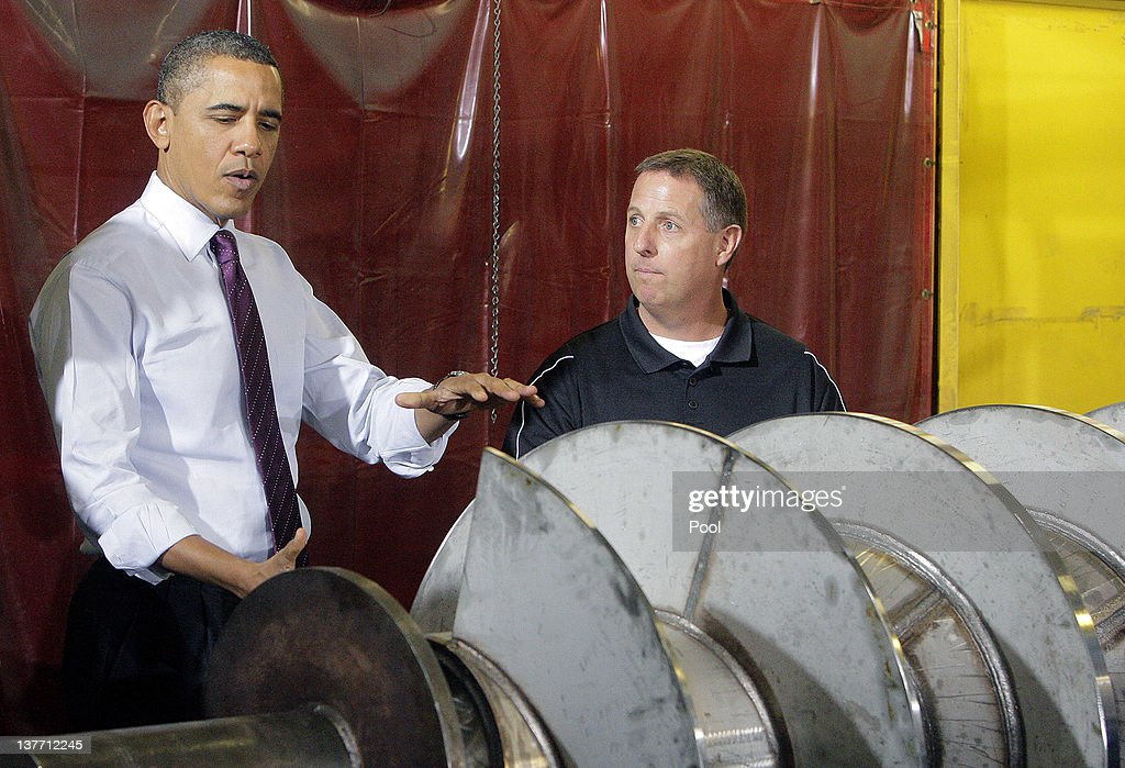 U.S. President <a gi-track='captionPersonalityLinkClicked' href=/galleries/search?phrase=Barack+Obama&family=editorial&specificpeople=203260 ng-click='$event.stopPropagation()'>Barack Obama</a> talks with Kris Kvach (right) about his job during a tour at Conveyor Engineering & Manufacturing January 25, 2012 in Cedar Rapids, Iowa. Obama, who is on a three-day tour, spoke about manufacturing and the economy during the speech.
