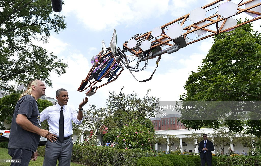 U.S. President <a gi-track='captionPersonalityLinkClicked' href=/galleries/search?phrase=Barack+Obama&family=editorial&specificpeople=203260 ng-click='$event.stopPropagation()'>Barack Obama</a> (R) talks with Lindsay Lawlor of San Diego, California, the builder of a robotic giraffe at the White House Maker Faire projects on the South Lawn June 18, 2014 in Washington, DC. The Faire is a series of projects by students, entrepreneurs and regular citizens using new technologies and tools to launch new businesses and learning new skills in science, technology, engineering and mathematics.