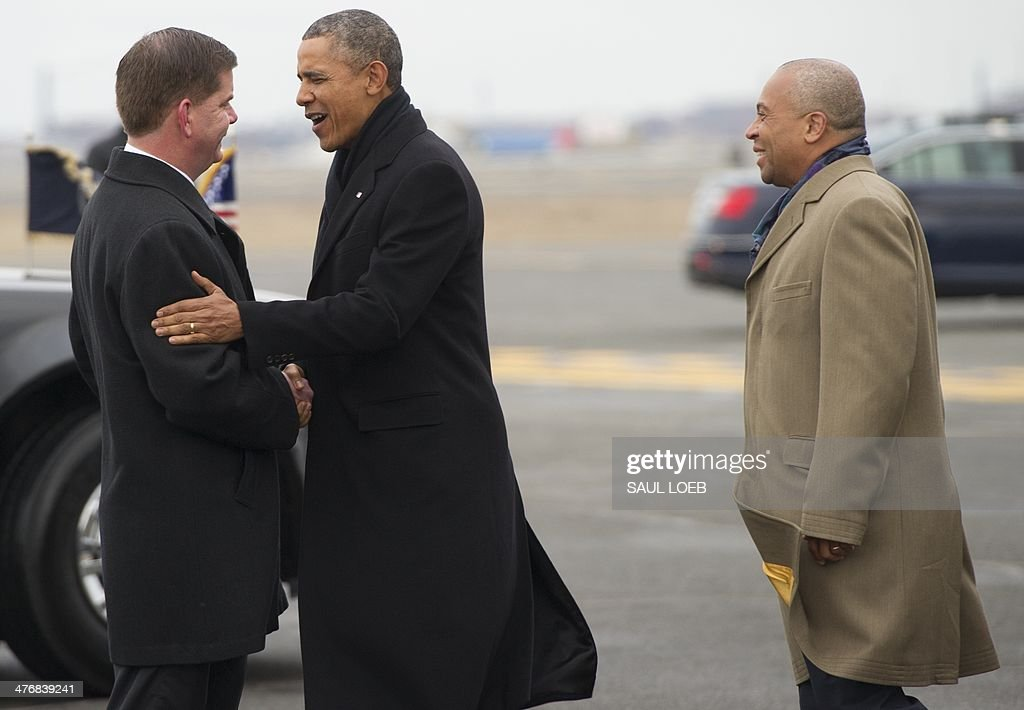 US President <a gi-track='captionPersonalityLinkClicked' href=/galleries/search?phrase=Barack+Obama&family=editorial&specificpeople=203260 ng-click='$event.stopPropagation()'>Barack Obama</a> talks with Massachusetts Governor Deval Patrick (R) and Boston Mayor Martin Walsh (L) upon arrival on Air Force One at Logan International Airport in Boston, Massachusetts, March 5, 2014. Obama is traveling to attend Democratic fundraisers. AFP PHOTO / Saul LOEB