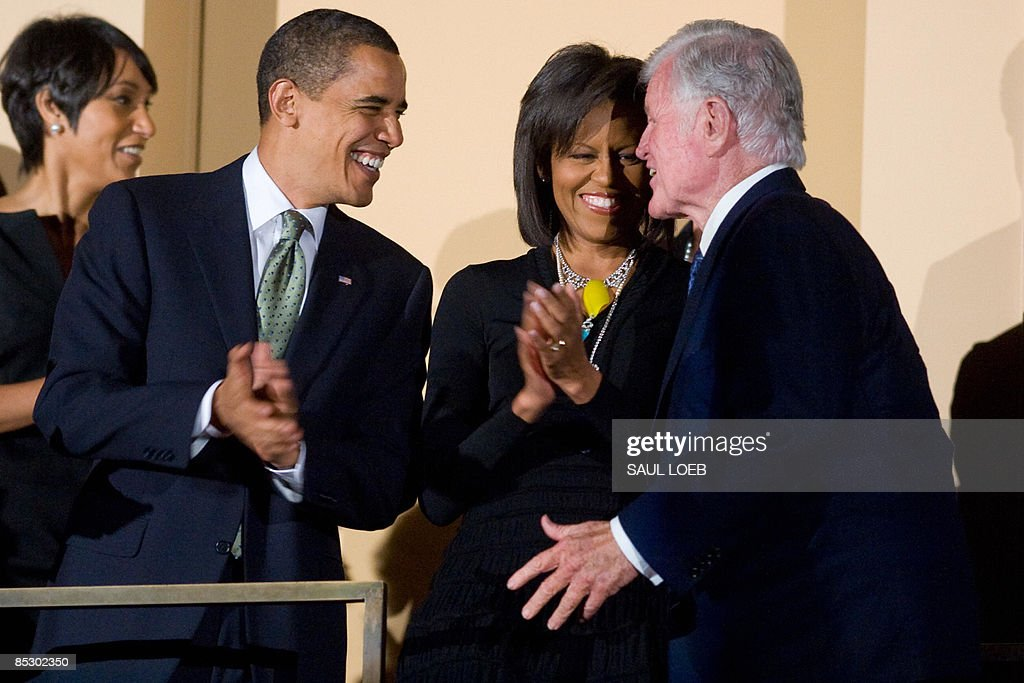 US President <a gi-track='captionPersonalityLinkClicked' href=/galleries/search?phrase=Barack+Obama&family=editorial&specificpeople=203260 ng-click='$event.stopPropagation()'>Barack Obama</a> talks with Massachusetts Senator Ted Kennedy (R) alongside First Lady <a gi-track='captionPersonalityLinkClicked' href=/galleries/search?phrase=Michelle+Obama&family=editorial&specificpeople=2528864 ng-click='$event.stopPropagation()'>Michelle Obama</a> during a musical birthday salute to Kennedy at the Kennedy Center in Washington, DC, March 8, 2009. AFP PHOTO / Saul LOEB