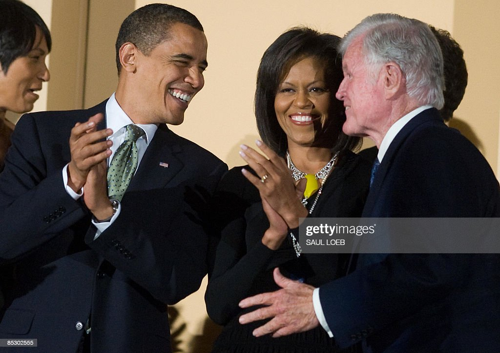 US President <a gi-track='captionPersonalityLinkClicked' href=/galleries/search?phrase=Barack+Obama&family=editorial&specificpeople=203260 ng-click='$event.stopPropagation()'>Barack Obama</a> talks with Massachusetts Senator Ted Kennedy alongside First Lady <a gi-track='captionPersonalityLinkClicked' href=/galleries/search?phrase=Michelle+Obama&family=editorial&specificpeople=2528864 ng-click='$event.stopPropagation()'>Michelle Obama</a> during a musical birthday salute to Kennedy at the Kennedy Center in Washington, DC, March 8, 2009. AFP PHOTO / Saul LOEB