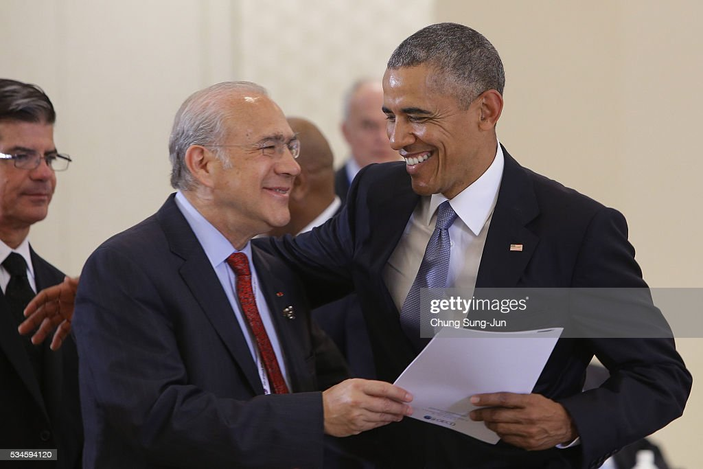 U.S. President <a gi-track='captionPersonalityLinkClicked' href=/galleries/search?phrase=Barack+Obama&family=editorial&specificpeople=203260 ng-click='$event.stopPropagation()'>Barack Obama</a> (R) talks with OECD Secretary General Angel Gurria (L) during 'Outreach Session' session on May 27, 2016 in Kashikojima, Japan. In the two-day summit, the G7 leaders are scheduled to discuss the pressing global issues including counter-terrorism, energy policy, and sustainable development.