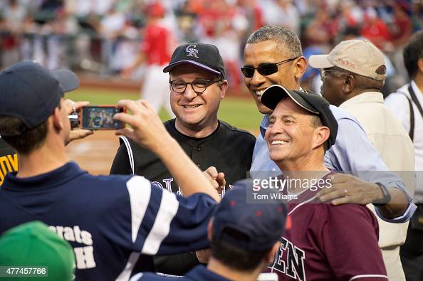 President Barack Obama talks with Reps Jared Polis DColo left and Ed Perlmutter DColo during the 54th Congressional Baseball Game in Nationals Park...