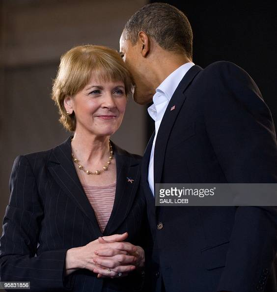 US President Barack Obama talks with US Senate candidate Democrat Martha Coakley during a campaign rally for Coakley at the Cabot Center at...