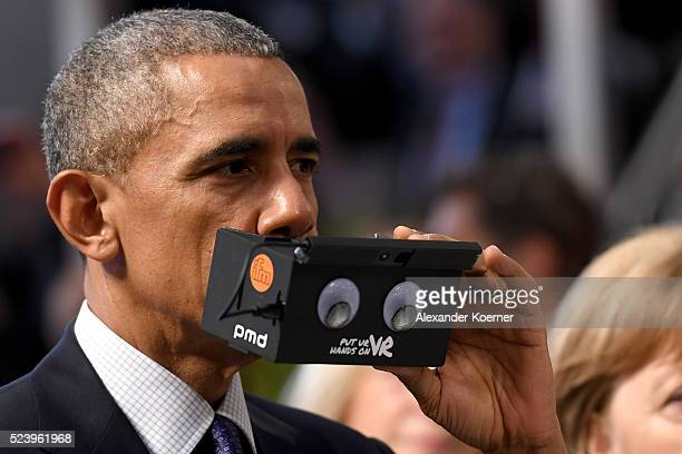 S President Barack Obama tests virtual reality glasses at the ifm electronics stand at the Hannover Messe industrial trade fair on April 25 2016 in...