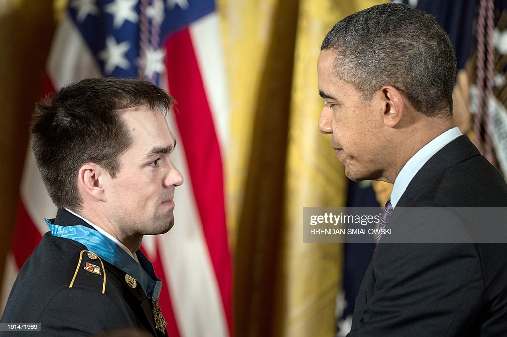 US President <a gi-track='captionPersonalityLinkClicked' href=/galleries/search?phrase=Barack+Obama&family=editorial&specificpeople=203260 ng-click='$event.stopPropagation()'>Barack Obama</a> thanks US Army Staff Sargent Clinton Romesha during a Medal of Honor ceremony in the East Room of the White House February 11, 2013 in Washington, DC. Army Staff Sargent Clinton Romesha was awarded the Medal of Honor for his gallantry during an insurgent attack on Combat Outpost Keating in Afghanistan in 2009. AFP PHOTO/Brendan SMIALOWSKI