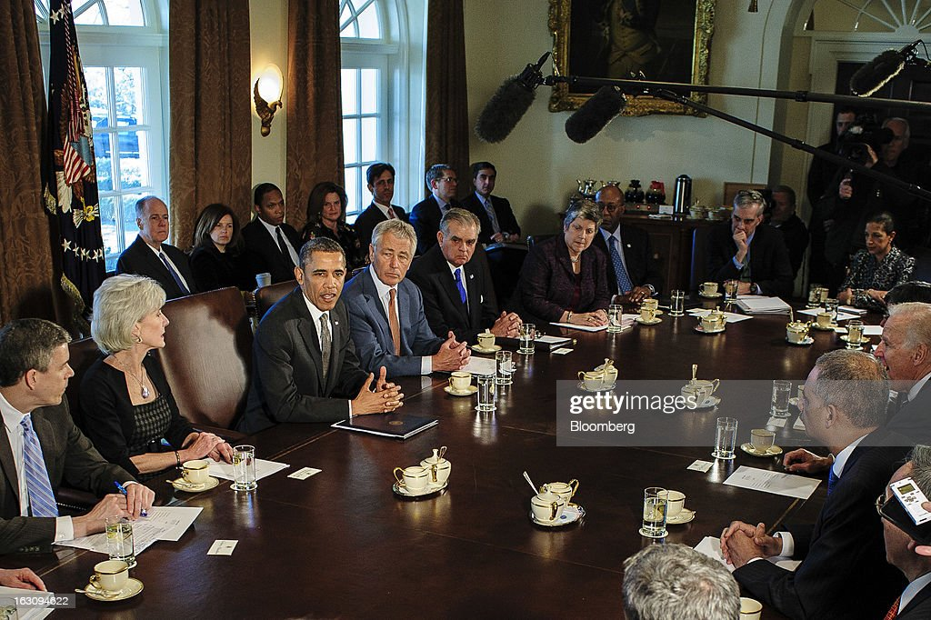 U.S. President <a gi-track='captionPersonalityLinkClicked' href=/galleries/search?phrase=Barack+Obama&family=editorial&specificpeople=203260 ng-click='$event.stopPropagation()'>Barack Obama</a>, third from left, speaks during a cabinet meeting at the White House in Washington, D.C., U.S., on Monday, March 4, 2013. Obama announced three cabinet-level nominations today, choosing Sylvia Mathews Burwell of the Wal-Mart Foundation as director of the Office of Management and Budget, scientist Ernest Moniz as head of the Energy Department, and Gina McCarthy to lead the Environmental Protection Agency, where she's been an assistant administrator. Photographer: Pete Marovich/Bloomberg via Getty Images