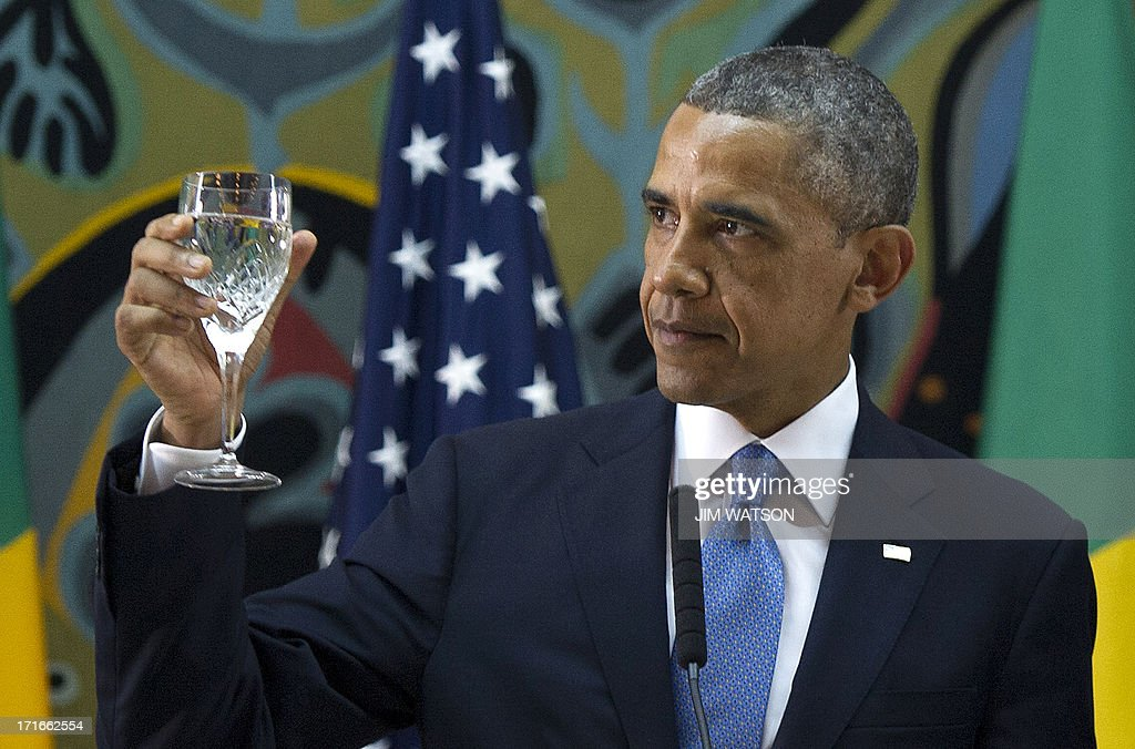 US President <a gi-track='captionPersonalityLinkClicked' href=/galleries/search?phrase=Barack+Obama&family=editorial&specificpeople=203260 ng-click='$event.stopPropagation()'>Barack Obama</a> toasts during an official dinner at the Presidential Palace in Dakar on June 27, 2013. Obama hit out at discrimination against gays in Africa and hailed the continent's 'amazing' progress and potential today on the first leg of a three-country tour.