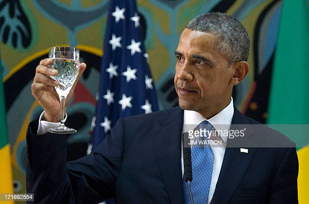 US President Barack Obama toasts during an official dinner at the Presidential Palace in Dakar on June 27 2013 Obama hit out at discrimination...