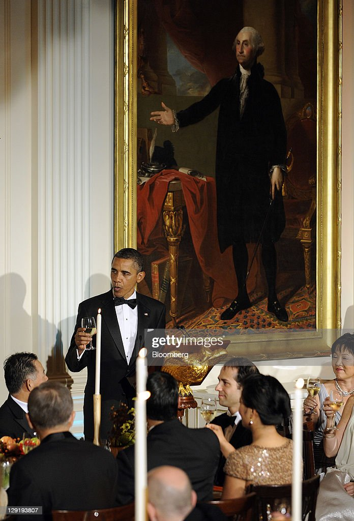 U.S. President <a gi-track='captionPersonalityLinkClicked' href=/galleries/search?phrase=Barack+Obama&family=editorial&specificpeople=203260 ng-click='$event.stopPropagation()'>Barack Obama</a> toasts Lee Myung-bak, president of South Korea, unseen, during a state dinner in the East Room of the White House in Washington, D.C., U.S., on Thursday, Oct. 13, 2011. Obama said the U.S. has an 'unbreakable' alliance with South Korea as he welcomed the Asian nation's president for a state visit. Photographer: Roger L. Wollenberg/Pool via Bloomberg via Getty Images