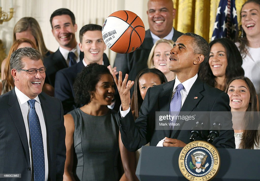 U.S. President <a gi-track='captionPersonalityLinkClicked' href=/galleries/search?phrase=Barack+Obama&family=editorial&specificpeople=203260 ng-click='$event.stopPropagation()'>Barack Obama</a> tosses up a basketball given to him by coach <a gi-track='captionPersonalityLinkClicked' href=/galleries/search?phrase=Geno+Auriemma&family=editorial&specificpeople=704607 ng-click='$event.stopPropagation()'>Geno Auriemma</a> (L) while honoring the 2015 NCAA Women's Basketball Champion University of Connecticut Huskies during a ceremony in the East Room at White House September 15, 2015 in Washington, DC. President Obama honored the Huskies for winning their third consecutive title with 10 overall.
