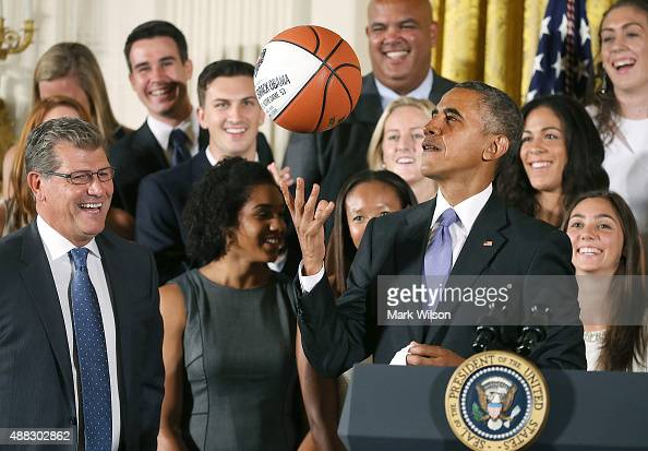 S President Barack Obama tosses up a basketball given to him by coach Geno Auriemma while honoring the 2015 NCAA Women's Basketball Champion...