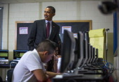 US President Barack Obama tours a seventh grade classroom that uses technology to enhance students' learning experience prior to delivering remarks...