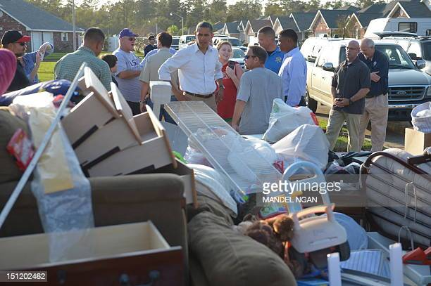 US President Barack Obama tours damage caused by Hurricane Isaac in LaPlace in Saint John the Baptist Parish Louisiana September 3 2012 AFP...