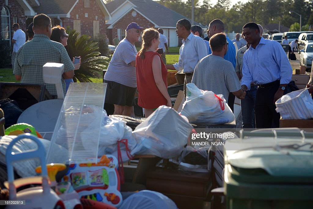 US President Barack Obama tours damage caused by Hurricane Isaac in LaPlace, Saint John the Baptist Parish, Louisiana, September 3, 2012. AFP PHOTO/Mandel NGAN