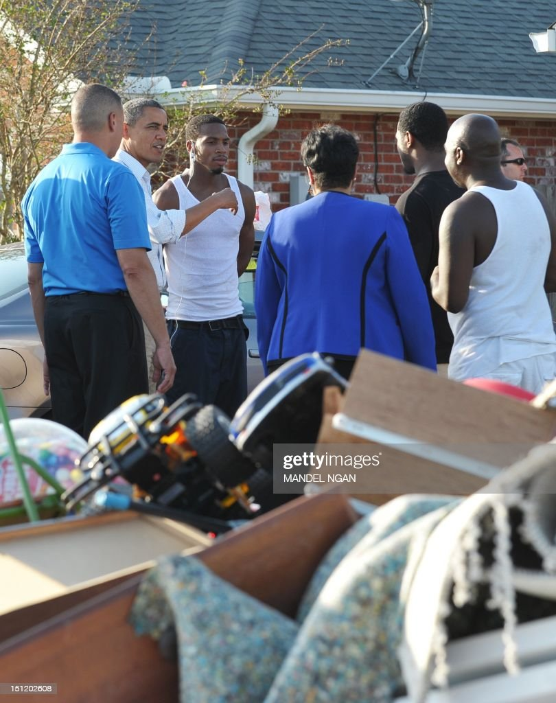 US President Barack Obama tours damage caused by Hurricane Isaac in the Ridgewood neighbourhood of LaPlace, Saint John the Baptist Parish, Louisiana, September 3, 2012. AFP PHOTO/Mandel NGAN