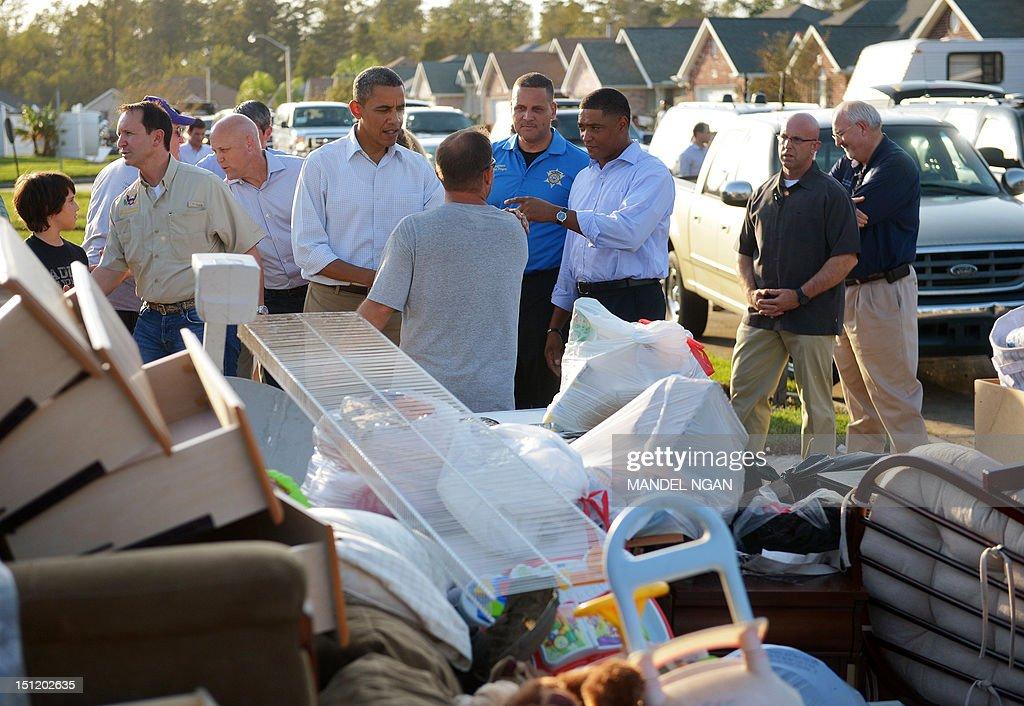 US President Barack Obama tours damage caused by Hurricane Isaac in the Ridgewood neighbourhood of LaPlace, Saint John the Baptist Parish, Louisiana, September 3, 2012. AFP PHOTO/Mandel NGAN