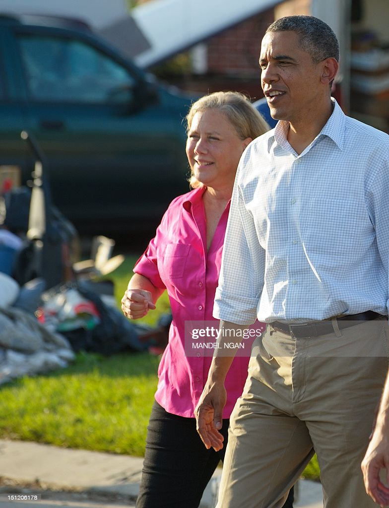 US President Barack Obama tours damage caused by Hurricane Isaac with Senator Mary Landrieu in the Ridgewood neighbourhood of LaPlace, in Saint John the Baptist Parish, Louisiana, September 3, 2012. AFP PHOTO/Mandel NGAN
