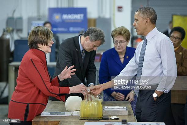 US President Barack Obama tours Magnet at Cleveland State University with Senator Sherrod Brown and Rep Marcy Kaptur March 18 2015 in Cleveland Ohio...
