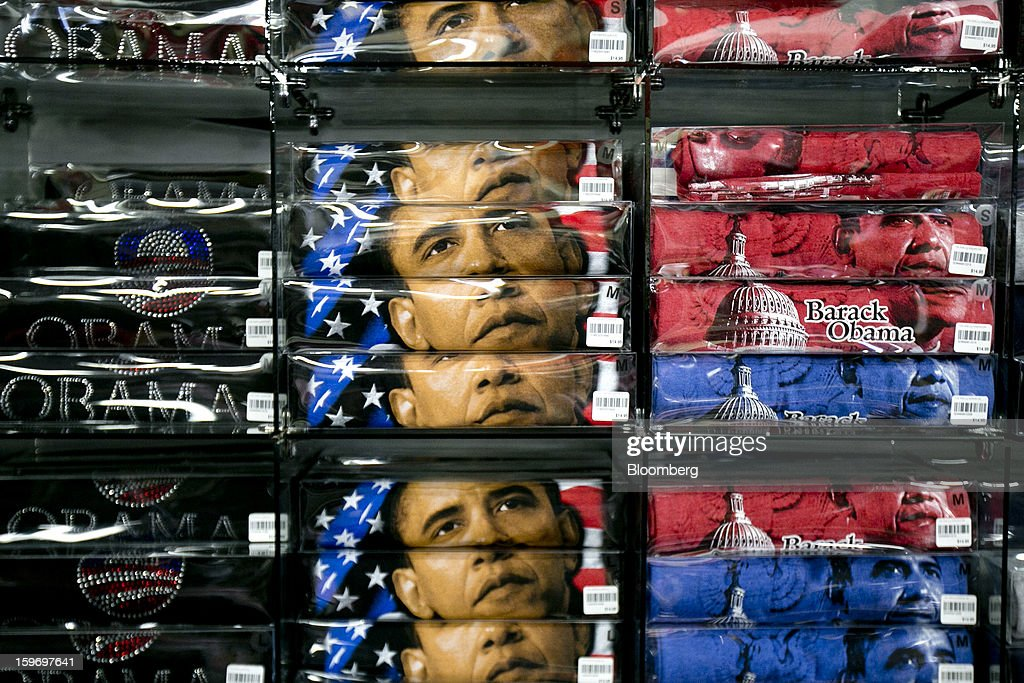 U.S. President Barack Obama t-shirts sit on display for sale at a gift shop in Washington, D.C., U.S., on Friday, Jan. 18, 2013. President Obama's second inauguration next week will combine the star power of Beyonce, Kelly Clarkson and James Taylor with a lineup that reflects social values Obama will champion in his new term. Photographer: Andrew Harrer/Bloomberg via Getty Images