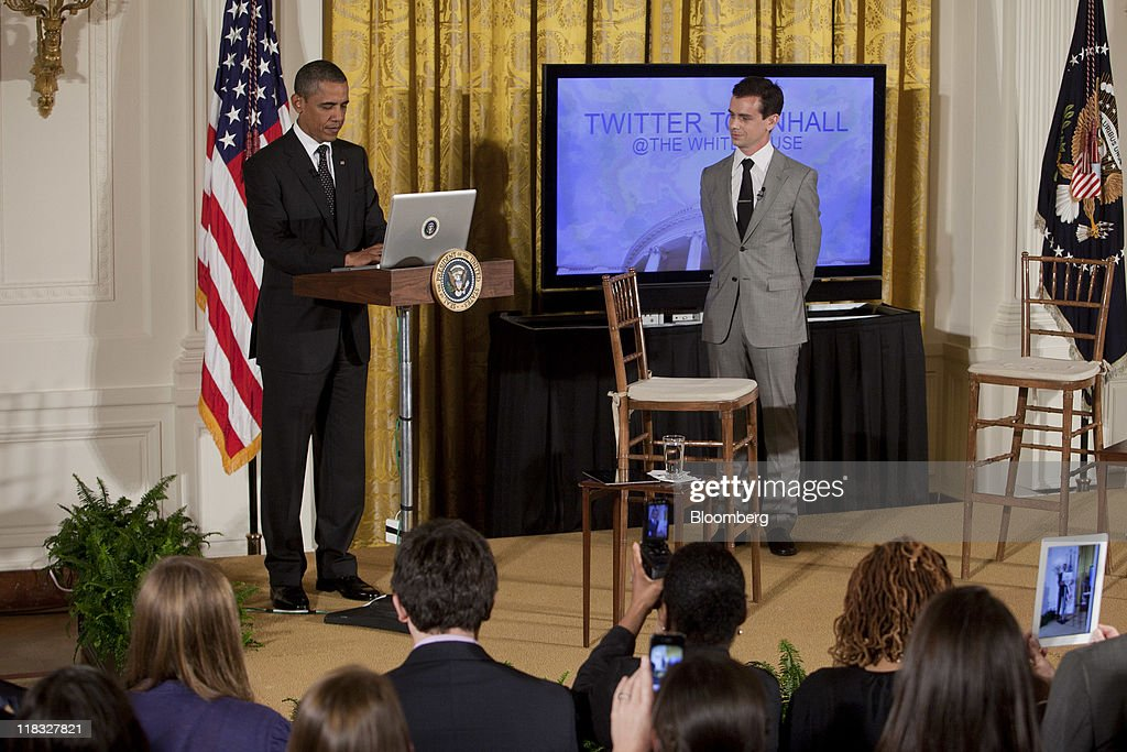 U.S. President <a gi-track='captionPersonalityLinkClicked' href=/galleries/search?phrase=Barack+Obama&family=editorial&specificpeople=203260 ng-click='$event.stopPropagation()'>Barack Obama</a> 'tweets' during a Twitter Town Hall meeting in the East Room of the White House with <a gi-track='captionPersonalityLinkClicked' href=/galleries/search?phrase=Jack+Dorsey&family=editorial&specificpeople=5818892 ng-click='$event.stopPropagation()'>Jack Dorsey</a>, co-founder and executive chairman of Twitter Inc., right, in Washington, D.C., U.S., on Wednesday, July 6, 2011. Obama, responding to questions submitted over Twitter Inc.'s service, said he wishes he had done more in the early part of his term to explain to Americans the depth of the recession. Photographer: Andrew Harrer/Bloomberg via Getty Images
