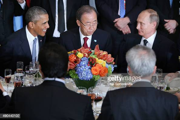 US President Barack Obama United Nations SecretaryGeneral Ban Kimoon and Russian President Vladimir Putin sit together during a luncheon hosted by...