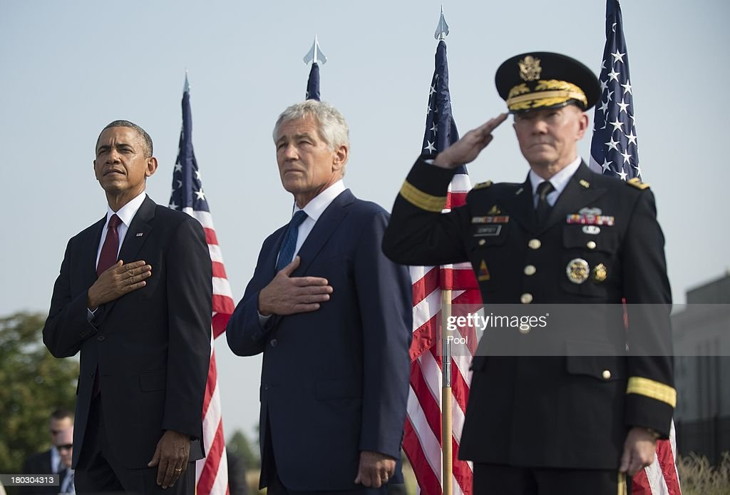 U.S. President Barack Obama, U.S. Defense Secretary Chuck Hagel and Chairman of the Joint Chiefs of Staff Martin Dempsey stand during a ceremony in observance of the terrorist attacks of 9/11 at the Pentagon September 11, 2013 in Arlington, Virginia. Family members of the Pentagon attack victims and survivors of the attack gathered to hear from Obama and other leaders at the National 9/11 Pentagon Memorial near the place where terrorists drove a jetliner into the Department of Defense headquarters in 2001.