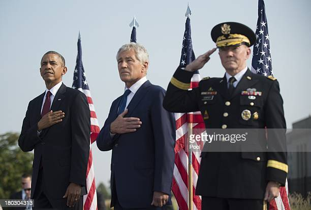 11 US President Barack Obama US Defense Secretary Chuck Hagel and Chairman of the Joint Chiefs of Staff Martin Dempsey stand during a ceremony in...