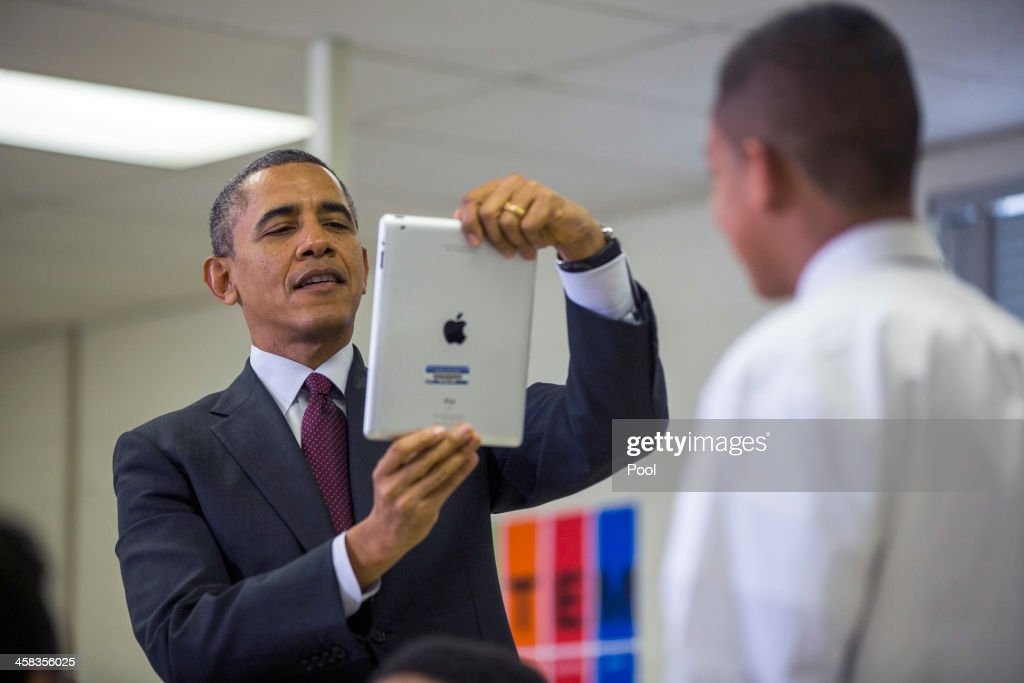 U.S. President <a gi-track='captionPersonalityLinkClicked' href=/galleries/search?phrase=Barack+Obama&family=editorial&specificpeople=203260 ng-click='$event.stopPropagation()'>Barack Obama</a> (L) uses an Apple iPad to record a seventh grader as he tours a classroom that uses technology to enhance students' learning experience, prior to delivering remarks on the ConnectED Initiative at Buck Lodge Middle School February 4, 2014 in Adelphi, Maryland. As part of the president's ConnectED program, Obama has tasked the Federal Communications Commission to help to build high-speed digital connections to America's schools and libraries, with the goal of getting 99-percent of American students to next-generation broadband and wireless technology within five years.