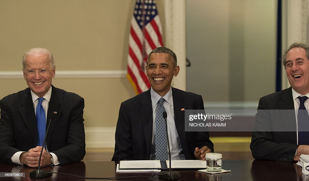 US President <a gi-track='captionPersonalityLinkClicked' href=/galleries/search?phrase=Barack+Obama&family=editorial&specificpeople=203260 ng-click='$event.stopPropagation()'>Barack Obama</a> (C), Vice President Joe Biden (L) and US Trade Representative <a gi-track='captionPersonalityLinkClicked' href=/galleries/search?phrase=Michael+Froman&family=editorial&specificpeople=5935975 ng-click='$event.stopPropagation()'>Michael Froman</a> (R) laugh as they attend the Democratic Governors Association Meeting in Washington, DC, on February 20, 2015.
