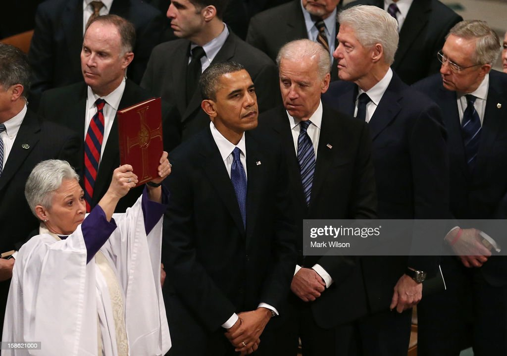 U.S. President Barack Obama, Vice President Joseph Biden, former U.S. President Bill Clinton, and Senate Majority Leader Sen. Harry Reid (D-NV) watch as the casket of Sen. Daniel Inouye (D-HI) is carried past during a funeral service at the National Cathedral on December 21, 2012 in Washington, DC. Sen. Inouye, who was the most senior senator and a Medal of Honor recipient, died on December 17 at the age of 88.