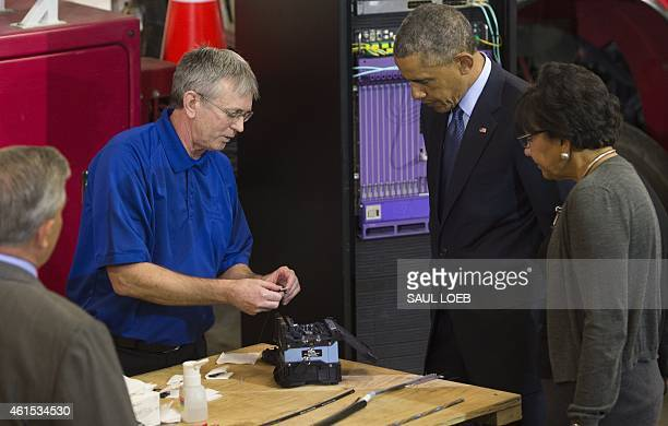 US President Barack Obama views a demonstration of fiber optic splicing alongside David Schilling Communications Services Manger and Commerce...