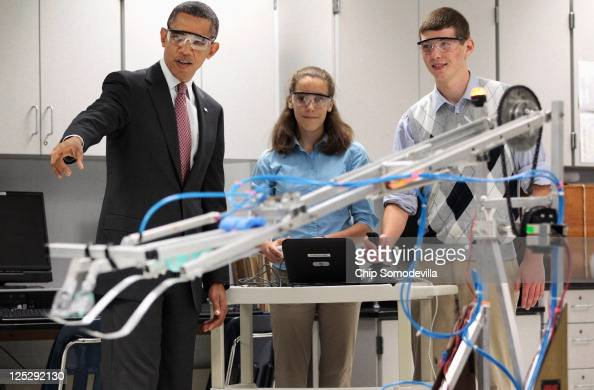 S President Barack Obama visits a classroom and watches students Meghan Clark and Nathan Hughes demonstrate the FIRST Robot a robot created in the...